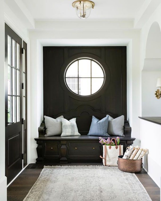 10 Inspiring Entryways.  Love the shape of the frame and paneling!