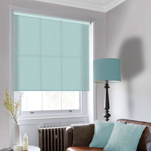 A made to measure roller blind in a light green colour
