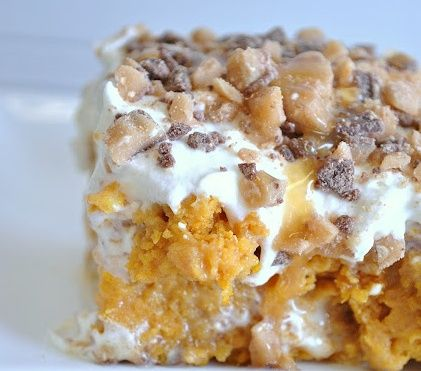 Its PUMPKIN Cake  1 box yellow cake mix 1 small can pumpkin puree 1 – 14 oz. can sweetened condensed milk 1 – 8 oz. tub cool whip 1/2 bag Heath Bits Caramel Sundae Sauce.
