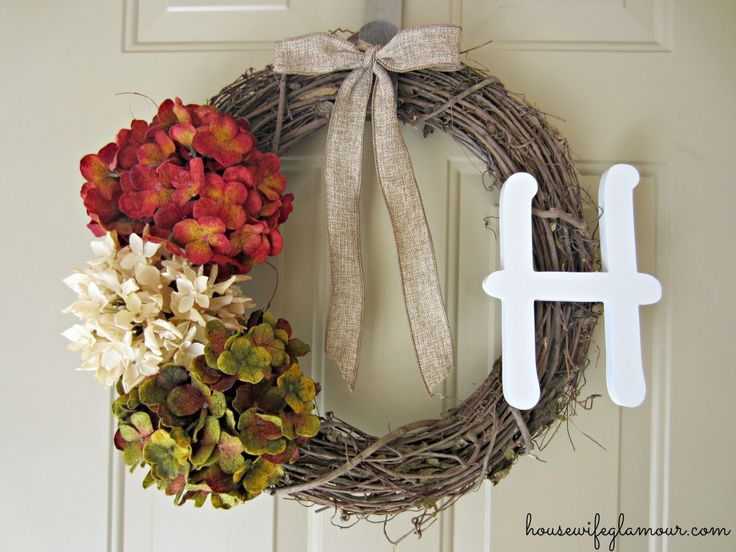 DIY wreath for front door using pipe cleaners to secure initial & flowers.