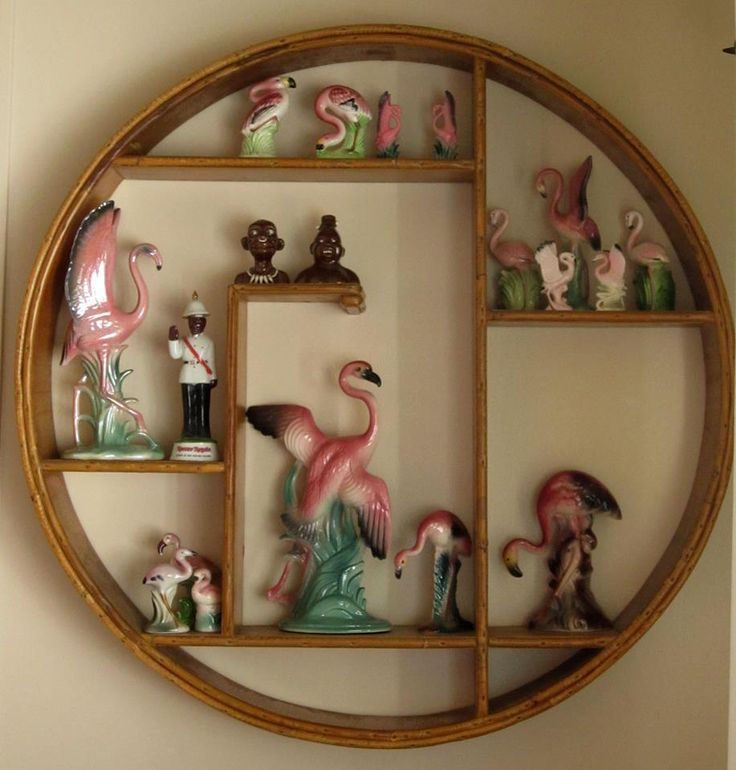 I saw this photo and thought it was one of my old photos at first. I collected flamingos in the 1970's and had this same circular shelf.