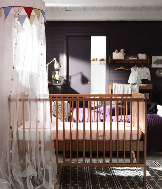Love the dark wall nursery