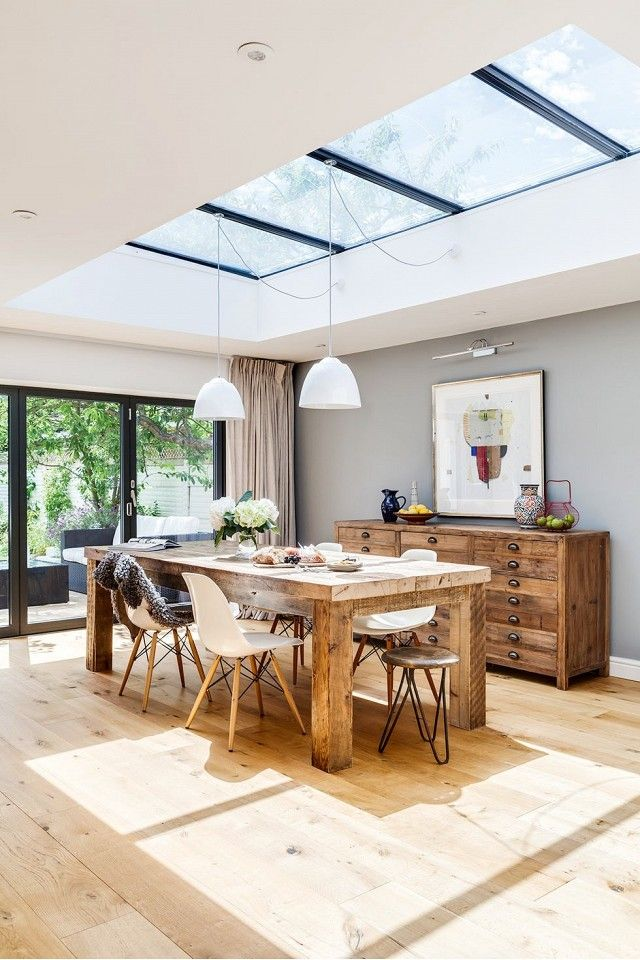 Dining area with a natural wood table and credenza