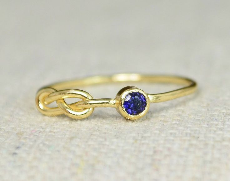 Sapphire Infinity Ring, Gold Filled Ring, Stackable Rings, Mother's Ring, September Birthstone Ring, Gold Infinity Ring, Gold Knot Ring by Alaridesign on Etsy https://www.etsy.com/listing/248270862/sapphire-infinity-ring-gold-filled-ring