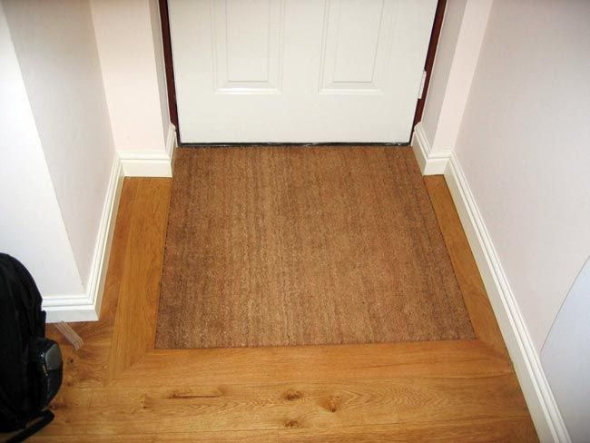 If move door out some, this would cover the tile difference. Flush inset door mat full size
