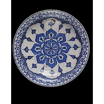 Dish      Place of origin:      Iznik, Turkey (probably, made)     Turkey (made)     Date:      ca 1580 (made)     Artist/Maker:      Unknown (production)     Materials and Techniques:      Fritware, underglaze painted in two shades of cobalt blue, glazed