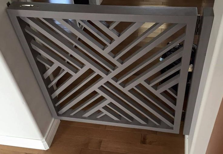 Dog Gate - Bringing wood back to baby gates…. Time to ditch the traditional plastic baby gate! Tree of Life Furniture designed this contemporary wooden gate with a beautiful geometric pattern. It's custom painted and wall mounted with a flush mount barrel bolt style locking pin.
