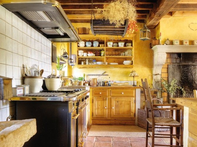 I want my kitchen to feel like this.  I've got the yellow walls but think I need the terra cotta floor tiles.