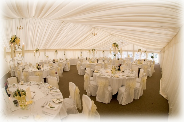 White cotton chair covers finished with ivory organza sashes at the beautiful Plas Isaf, Corwen