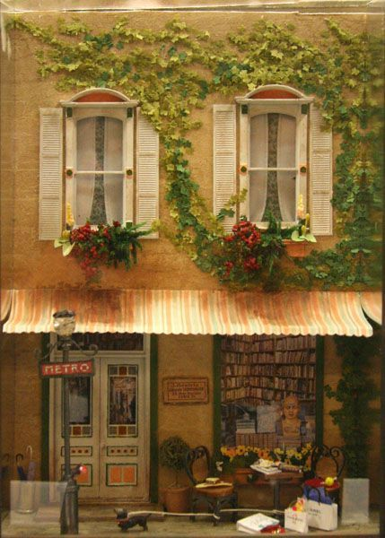 Flat backdrop quarter scale Paris street scene in a windowbox frame by Charlotte Atcher exhibited at the Fall 2009 Seattle Dollhouse Miniature show.