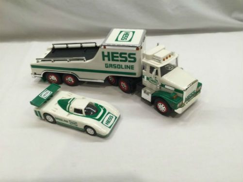 Vintage 1988 Hess Toy Truck and Racer. Breaking tradition the 1988 Hess Toy Truck and Racer was not a replica of any actual Hess vehicle and this was the first year that truck was offering two toys in one. This first ever combo toy showcased a trailer truck and a GT-styled with a friction-powered racing car. Breaking firsts was the license plates on the truck and racer, each beard the year of issue!