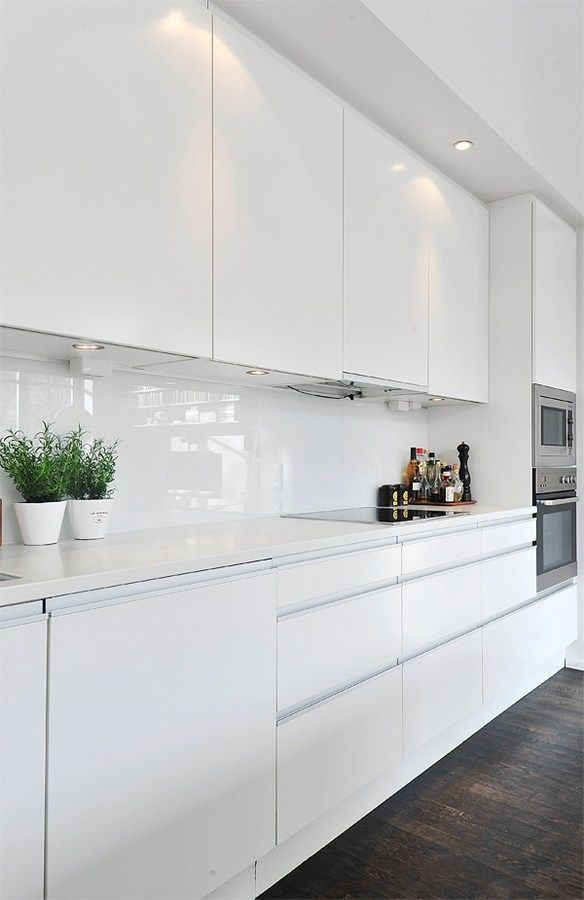 Splashback inspiration, white glass splashback to compliment the all white kitchen - Found on Pinterest