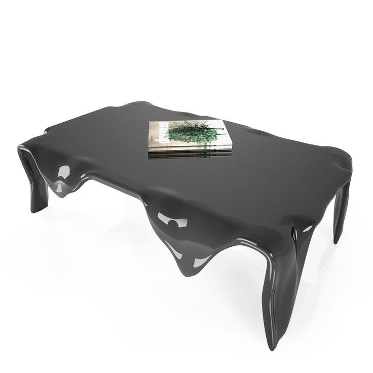 QUADRO, l'idea del tavolino, nasce dalla visione della realtà presentata e raffigurata nei quadri surrealisti, dove le forme di oggetti reali si trasformano e si modellano nella mente dell'artista che li deve rappresentare, infatti essi si torcono, si liquefanno, assumendo forma diversa dalla realtà. Designer: Maurizio Poli