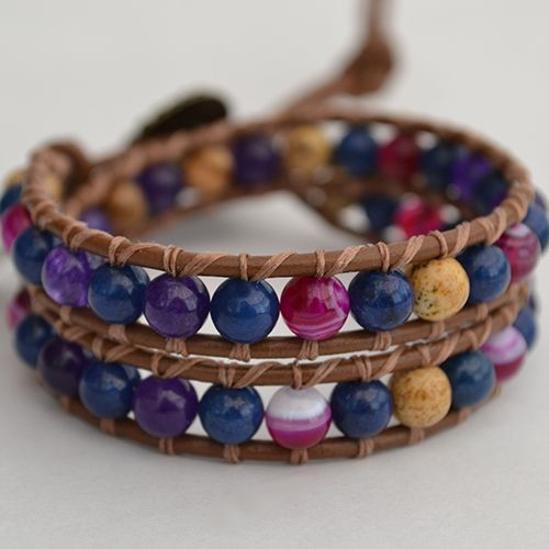 Our Endless wrap bracelet has been designed with a combination of deep purple Amethyst, Pink Stripe Agate, Picture Jasper and Lapis Lazuli Gemstones. The natural properties of these stones work harmoniously with our energies to bring balance, strengthen our love relationships and heighten our spiritual awareness.  On brown genuine leather (or vegan alternative*), finished with a unique bronze button clasp. Can be purchased in two optional sizes fo…