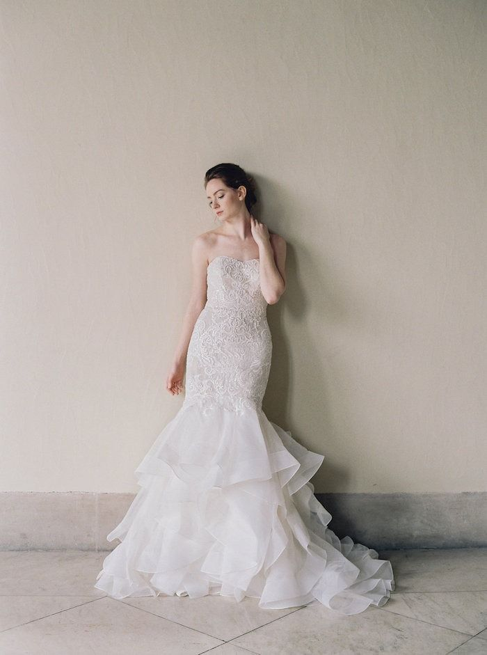 Popular  Delicate layers of chiffon on a trumpet style just bring a sigh of delight Shop this strapless sweetheart neckline trumpet wedding dress by Oleg Cassini