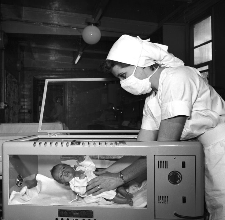 premature baby is seen being cared for in an oxygen tent at Burtonwood, Lancashire, in 1956.