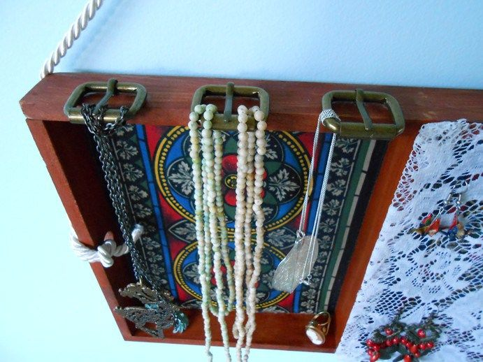 Necklace hangers made from antique-style belt buckles