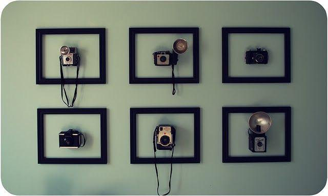 Framed vintage cameras.