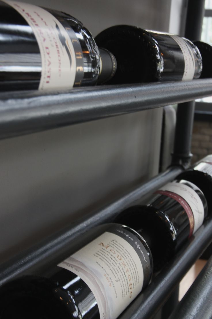 Hand crafted wine rack that hosts some of our local Greek and imported Italian Wines.