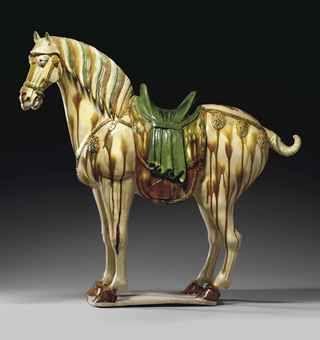 A LARGE AND FINELY MODELED SANCAI-GLAZED POTTERY FIGURE OF A FERGHANA HORSE