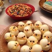 Fun Easter Chicks Deviled Eggs   Ingredients  2 dozen eggs  your choice of type of mustard  Mayonnaise or use yogurt if you like  Sweet pickle relish  Celery Salt  Paprika  Part of a can of black olives and carrot slivers  Instructions  Prepare deviled eggs as normal then...  Cut the Tops off the eggs and stuff with mixture. Use black olive pieces for eyes and small slivers of carrot for a nose. Stick the top back on at an angle like a hat to make the eggs look like chicks.