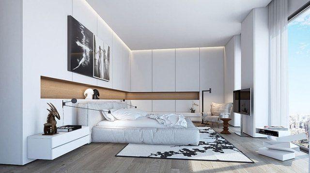 Les armoires réalisées sur mesure occupent tout l'espace mural disponible dans cette grande chambre au style moderne, où le blanc domine.