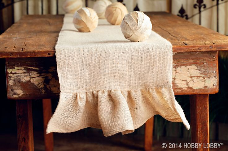Want a table that's très chic? Try adding a sweet burlap table runner. It's a project that doesn't require a pattern. Simply measure and cut fabric to the desired size. Then sew on a simple, gathered ruffle. Now the talk around the table is all about your boutique-worthy style!