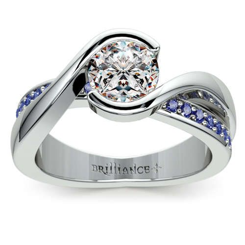 Shimmering blue sapphires and diamonds come together beautifully in this new piece by Brilliance... Meet the Bezel Sapphire Gemstone Bridge Ring in durable Platinum, featuring pave-set sapphires enhancing the Round-cut center diamond! http://www.brilliance.com/engagement-rings/bezel-sapphire-gemstone-bridge-ring-platinum