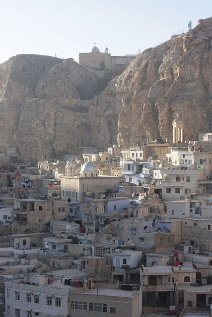 Maaloula, Syria. Homes carved out of the side of the mountain. An amazing sight to see