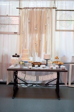 dessert table style: simple and organic with small cake and scattered desserts
