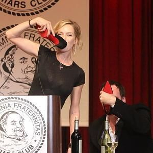 Uma Thurman drinking champagne in Christian Louboutin pumps
