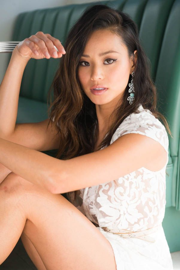 I always say I'm over lace, but that's a lie. Jamie Chung. White lace dress. Chandelier earrings.