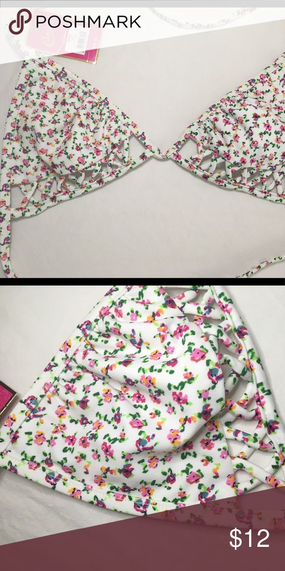 NWT Candies floral triangle bikini top Never been worn S triangle bikini top. Still has the tag, cute floral print with a crisscross pattern underneath the bust. Candie's Swim Bikinis