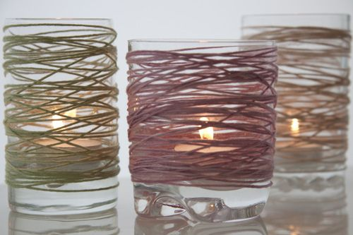 Candle holders wrapped in different colored twine. OR wrap them, spray paint them, then remove the twine.