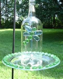 wine bottle bird feeder---So gonna make one of these!