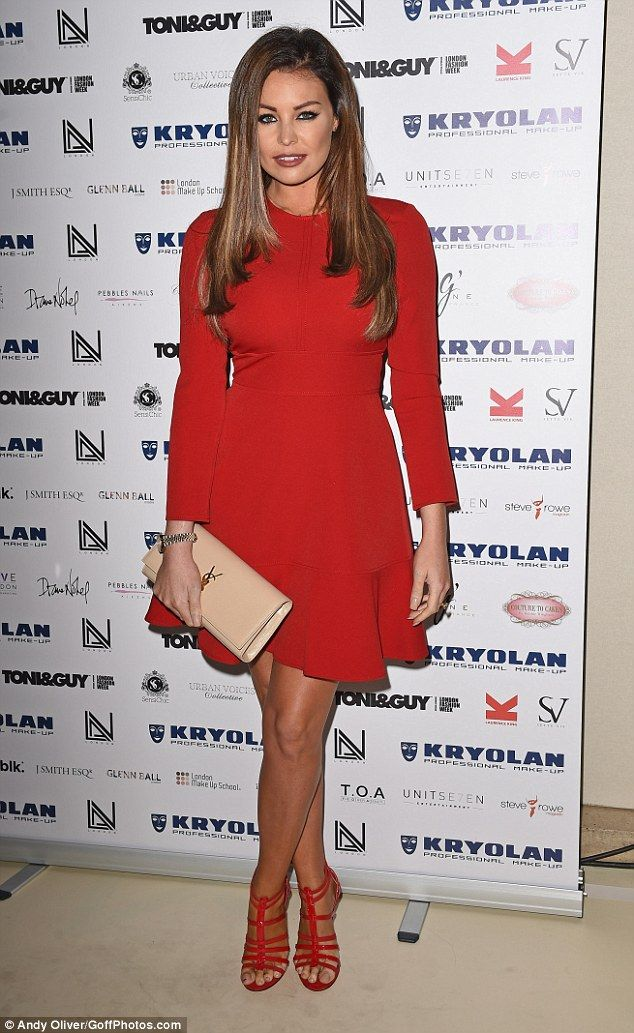 Flirty thirty: Jess Wright looked as youthful as ever when she stepped out for an evening in London on Thursday, attending Lan Nguyen-Grealis' Make-up book launch, in a vampish red midi dress
