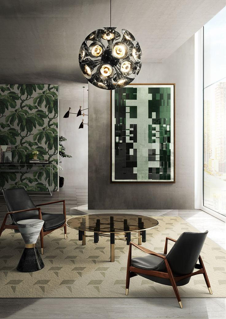 The living room pictured above features a mixture of styles that are all linked by small golden details. At the center, you have the delicate Konstantin Center Table surrounded by two lovely chairs and the black and white marble Vinicius Side Table. On the ceiling, you have the exquisite Botti Pendant. That modern chair is the perfect inspiration!