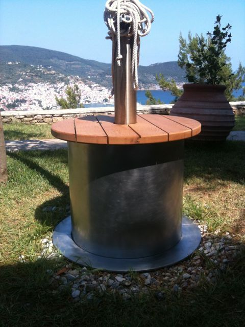 Table at mast base, stainless steel and teak. #stainlesssteel #metalwork #stainlesssteeldesign #outdoortable
