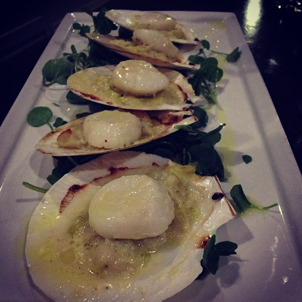 Scallops in half shell baked with creamed leak, macadamia and parmesan from Kettle & Tin in Paddington