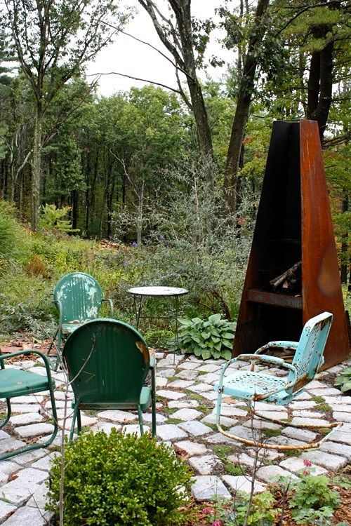 lovely outdoor space from landscape designer Rochelle Greayer.  I have some of these old metal chairs.  Would be great for this.