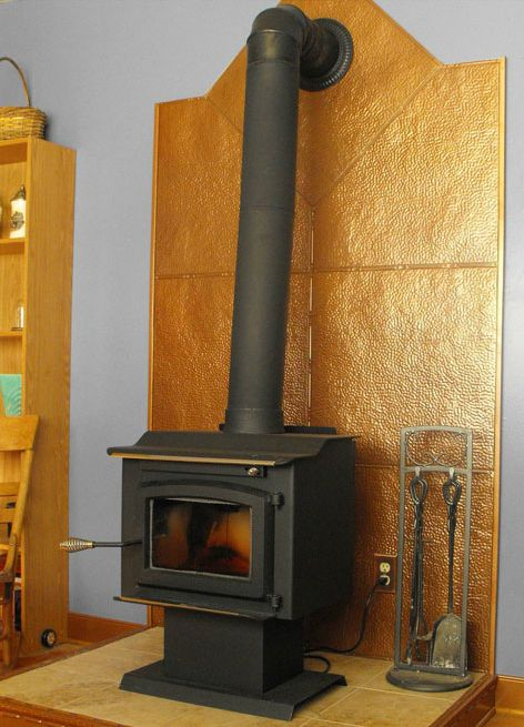 An Old World Stove Accented By A Copper Wall Made Of Tin Tiles Http: