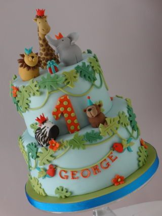 I have just joined this wonderful site and thought that the first cake I would upload should be this fun cake I made just over a year ago. I really enjoyed modelling all the little animals :-)