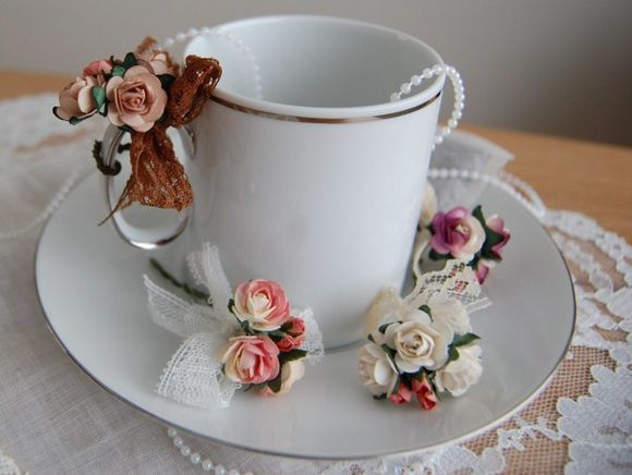 These adorable tea-cup rose charms from Etsy add a classic and romantic feel.