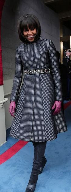 First Lady wears Thom Browne coat, J. Crew  belt and gloves and Reed Krakoff boots during Inauguration Ceremony