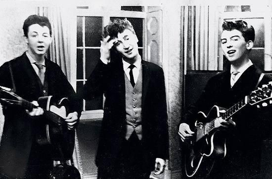 History In Pictures ‏@History In Pics   Paul McCartney, John Lennon & George Harrison performing at a wedding reception, 1958