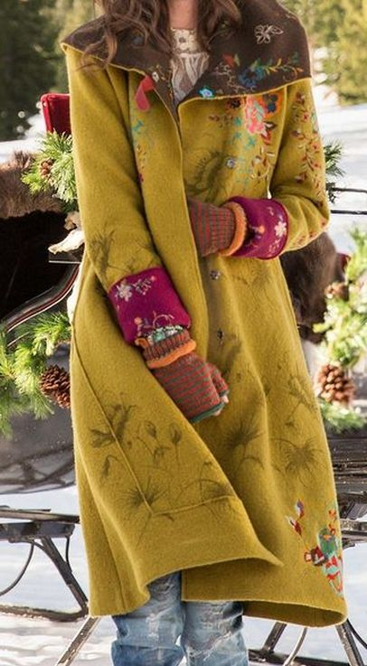 LEGENDS OF THE FOREST COAT -- Boiled wool coat takes embellishment to a new level with shadowed poppies and vibrant embroidered blooms. Fully lined. On-seam pockets. Leather buckle keeps hood snug. Merino wool. About 450 euro. Robert Redford's Sundance Catalog.