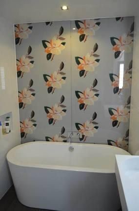 Give your bathroom a makeover with a custom printed glass splashback.