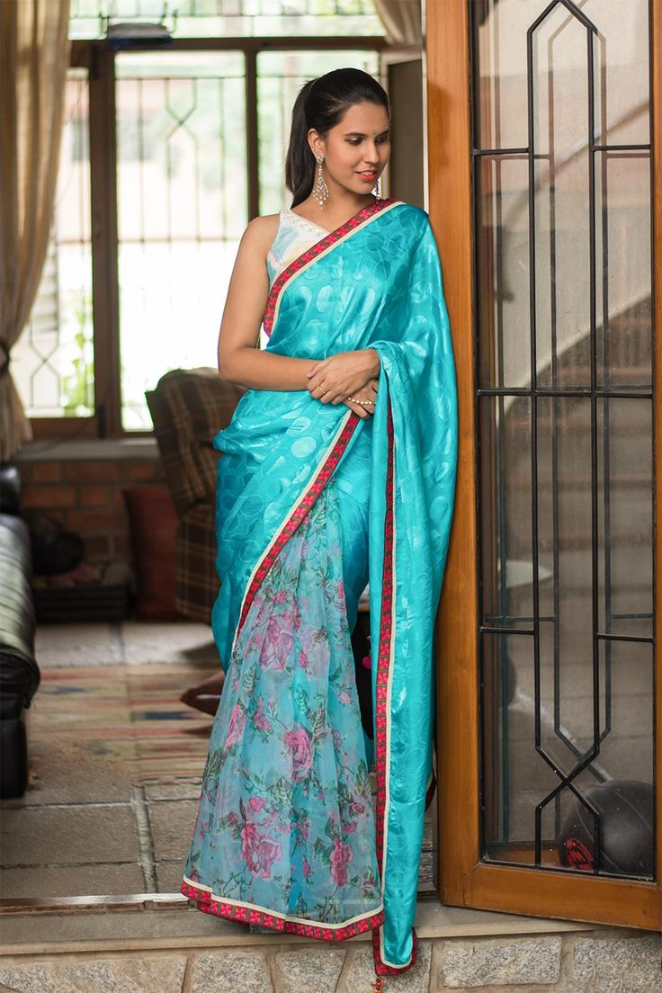 Shades of sea with colors of sun during spring sums up the hues of the saree. The vibe is chic while the viscose georgette  is all about comfort. The blue against the red border works soothingly on the eyes while we drool over the floral printed pleats. Pair her with an electric blue blouse for a fierce look. ACCOMPANIMENTS: All sarees are sold completely finished with falls (where required) and a free size underskirt. FABRIC:  Saree – Icy blue viscose georgette with self embossed polka…