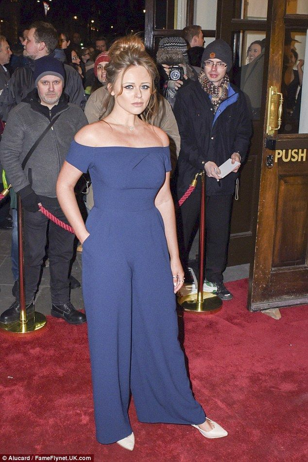 Demure: The 26-year-old concealed her curves in a tailored jumpsuit as she wore nude stile...