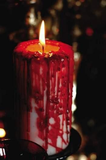 Easy way to make a very spooky candle for Halloween...a white candle with the drippings from a red candle.  That's it!